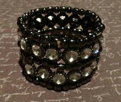 Check out this item in my Etsy shop https://www.etsy.com/listing/260007131/metal-faux-gem-bracelet-faux-gem-formal