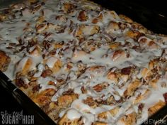 Cinnamon French Toast Bake 2    INGREDIENTS    1/4cup melted butter  2cans (12.4 oz each) Pillsbury® refrigerated cinnamon rolls with icing  5 eggs  1/2cup heavy whipping cream  2teaspoons ground cinnamon  2teaspoons vanilla  1cup chopped pecans  3/4 cup maple syrup  GARNISH    Icing from cinnamon rolls  Powdered sugar  Maple syrup, if desir