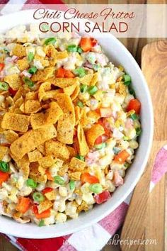 This unique, creamy corn salad is loaded with shredded cheddar cheese and Chili Cheese Fritos! from Dinner at the Zoo - Quick and Easy Re. Blt Pasta Salads, Greek Salad Pasta, Veggie Pasta, Corn Salads, Spinach Salads, Potluck Salad, Potluck Dishes, Food Dishes, Side Dishes