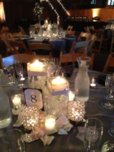 Classic Formal Hollywood Glam Informal Romantic Vintage Silver White Ballroom Centerpiece Country Club Decor Fall Museum Orchid Restaurant Rose Spring Summer Winter Wedding Flowers Photos & Pictures - WeddingWire.com
