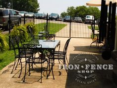 Great DIY project using wrought iron fence and gates to close off a portion of driveway to act as a patio