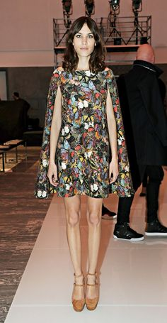 Alexa Chung wears a butterfly print Valentino cape dress with platform heels