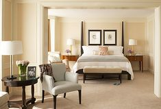 """Double Hanging pics over headboard for """"hotel vibe"""" that is sophisticated and classic."""