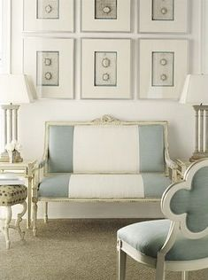 Lovely use of a creamy white linen, centered between a wider stripe of storm blue/gray.  The chalk painted chair has been upholstered in a solid colorway of the stripe.     Suzanne Kasler design.