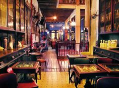 """Named as one of the top 10 bars in the world, Frommer's also calls Rio Scenarium the """"most beautiful bar in Rio."""" Located in a renovated warehouse on the edge of Lapa, this antiques-store-turned-bar is one of the places that played a big role in reviving Lapa's nightlife and famous music scene."""