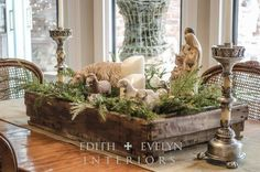 Vintage Nativity Centerpiece - This beautiful vintage tray gets new life with this Christmas Nativity scene. It's filled with soft pine boughs and flameless tapers that creates a most sublime centerpiece.