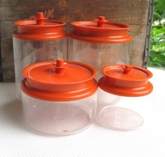 Vintage set of Tupperware Canisters. Fabulous four canister collection with orange lids and clear acrylic body. Lids are push button to open and Tupperware Canisters, Vintage Tupperware, Retro Vintage, Vintage Items, Vintage Stuff, Canister Sets, Vintage Dishes, Retro Toys, Craft Storage