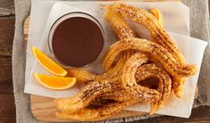 Churros with Chocolate Orange Sauce Traditionally eaten with coffee for breakfast, these Spanish doughnuts are an impressive dessert for entertaining. Cookie Desserts, Just Desserts, Delicious Desserts, Churros, Dessert Salads, Dessert Recipes, My Favorite Food, Favorite Recipes, Impressive Desserts