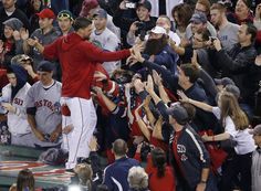 Boston Red Sox catcher Ryan Lavarnway celebrates on the dugout with fans after the Red Sox beat the Detroit Tigers 5-2 in. Game 6 of the ALCS.