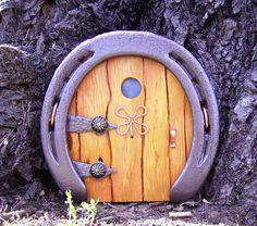 Horseshoe fairy / troll / hobbit door with copper wire clover