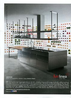 Arclinea kitchen w suspended shelves and hood above island