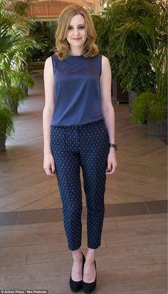 Laura Carmichael, who plays Lady Edith, opted for a navy blue ensemble in a simple shift top and printed cigarette pants