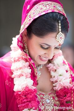 Indian wedding garland - jai mala - different shade of pink carnations create this wonderful effect