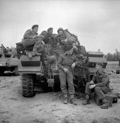 Troopers of the 12th Manitoba Dragoons with a Sherman tank of a Canadian armoured regiment near Caen, France, July 19th 1944. (Left To Right): Troopers Charles Barlow, Duncan McDonald, Norman Tester, Peter Palichec and Wallace French.