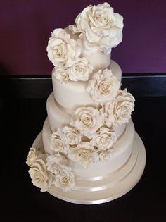 Ivory roses 4 tier wedding cake