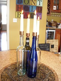 Wine Bottle Candle Holders    spray paint bottles black and stick on labels