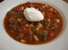 1 lb Ground Beef, cooked and drained 1 can corn 1 can Great Northern Beans(white) 1 can Black Beans 1 can Red Beans 1 can Diced Tomatos 1 Hidden Valley Ranch packet 1 Taco seasoning packet 2 cups water