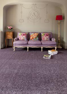 Doe 's gek en koop een paars tapijt!