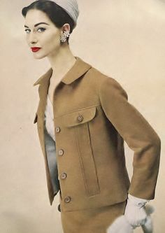 A silk-lined Ben Zuckerman suit from 1954 partnered with timelessly gorgeous make-up.