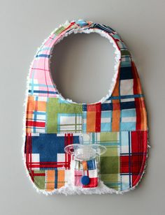 You'll never lose your baby's pacifier and you'll keep the mess off your little one's clothes with the Binky Bib Pattern. This special DIY bib features a binky strap that allows you to pacify your baby and also keep track of those small pacifiers. Baby Bibs Patterns, Sewing Patterns Free, Free Sewing, Pattern Sewing, Baby Sewing Projects, Sewing For Kids, Sewing Ideas, Sewing Box, Sewing Tips