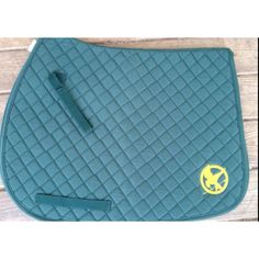 Embroidered Hunger Games English saddle pad  www.facebook.com/whinneywear www.whinneywear.com