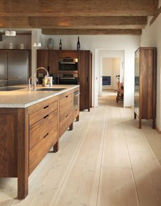 I am so attracted to this kitchen it's not even funny... From the plank floor boards to the cabinets and appliances!! WOW!