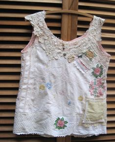 my bonny Wearable Collage Folk Art Lady in Garden Embroidery   happy combo of many all-vintage/antique linens, crochet & embroidery sweet pink dress Wearable Folk Art. I collaged on by machine and hand antique and vintage linens richly textured and