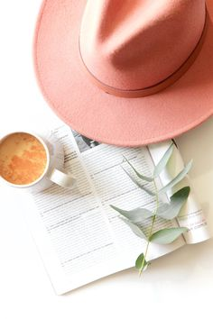 Styled Product Photo Modern Minimalist Feminine Magazine Pink Hat Coffee Flatlay. A Lack of Color. Free People. Anthropologie. Fashion Beauty Travel Blogger Pink Champagne Rosé French Flatlay. Bespoke Styled Product Photography + Photographer in California and Australia by Chelsea Loren.