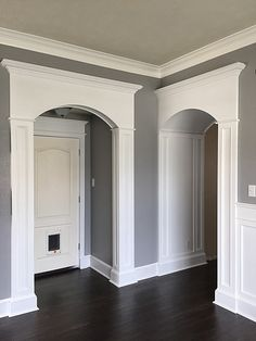 DIY columns and arch trim made out of MDF and store-bought moldings. See how they were made over at SovereignCarpentry.com