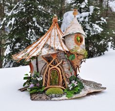 the beauty of natural materials; using small branches and birchlogs to build a fairyhouse, nice work of Sally J. Smith