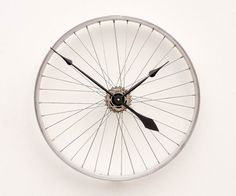 I don't have a place in my home for this but I think it's so cool! Recycled Bike Wheel Clock by pixelthis