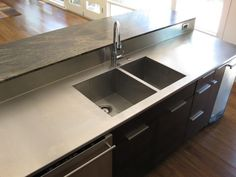 This Is A One Inch Thick Stainless Steel Countertop With An Integrated Sink  And Backsplash. The Countertop And Backsplash Were Made From On.