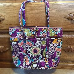 Plum Crazy Vera Tote super cute!! this has been used, but there is a ton of life left! no staining! the only issue is that the cardboard on the bottom is a little warped! so cute. Vera Bradley Bags Totes