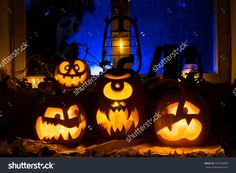 Photo Composition From Three Pumpkins On Halloween. Embittered, The Cyclops And Frightened Pumpkins Against An Old Window, Dry Leaves And A Terrible Ghost With A Knife In A Window - 331545839 : Shutterstock