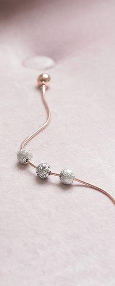 Adorn your PANDORA Rose bracelet with sterling silver charms from the PANDORA ESSENCE Collection.