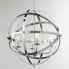 """Polished Chrome Metal Globe Pendant This luxe openwork fixture commands attention. The interchangeable design is perfect for any aesthetic from modern to traditional. Requires (4) 60 watt candle base bulbs. (35""""Hx20""""W)"""