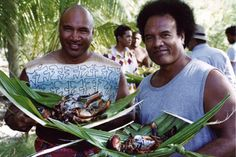 Vasa and Opetaia eating crabs on a very small Island in Tokelau