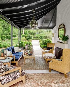 On a handsome porch in Nashville, a chocolate ikat pattern covers the teak armchairs. Click through for more outdoor upholstery fabrics.