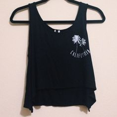 NWT black california tank NWT black california tank. *not brandy but similar to the cindy tank* size m but will fit sizes xs-m. bought for $27. price negotiable, bundle to save! Brandy Melville Tops Tank Tops