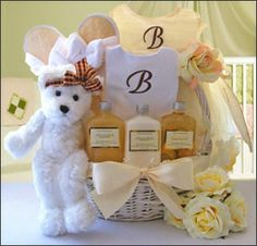 Mommy & Me = What an elegant and unique gift basket for the new baby girl! Our adorable floral dress is personalized with baby's first initial. Mom will be delighted with the lightly scented vanilla spa products and loofah slippers. A matching bib and fluffy teddy bear make this one gift to remember