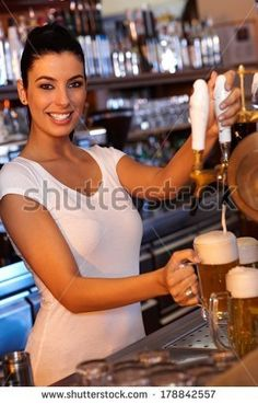 stock-photo-portrait-of-attractive-female-bartender-tapping-beer-in-pub-looking-at-camera-smiling-178842557.jpg (300×470)