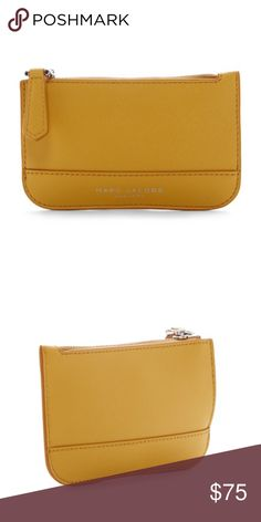 """Marc Jacobs Saffiano Key Pouch NWT A small leather key pouch that stores your keys, coins and cards in one place so you don't lose any one item.  - Top zip closure - Keyring detail - Approx. 3.25"""" H x 5.25"""" L x 0.5"""" W  - Imported Marc Jacobs Accessories Key & Card Holders"""
