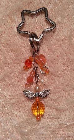 Gennt / kľúčenka, ozdoba na tašku s oranžovým anjelikom