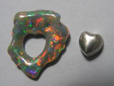 Dark Opal fromLightning Ridge (Australia).Very bright. Sterling silver heart insert. Carvd by Daniela & Orietta L'Abbate