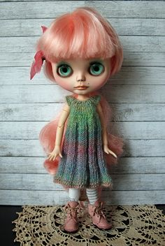 This listing is for a very simple, colorful and somewhat rustic hand knit dress for your Blythe doll. This sweet dress has been knit with a lovely