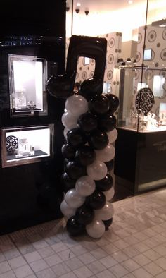 Black and White column with large music note feature balloon