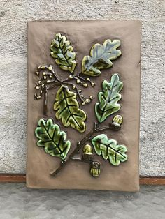 A lovely ceramic tile with oak leaves and acorn, Jie Gantofta, 1970s/ 1980s.  Condition Very nice, no chips or cracks, but there is a small hole in the clay on a brim, from the manufacturing process I think. Look close on pic 1.  Measurements 23 cm / 9,1 x 15,5 cm / 6,1  Important information - Read this before you decide to make a purchase.  - If the shipping costs are less than you are charged for I will refund.  - If you buy more than one item, in most cases the shipping cos...