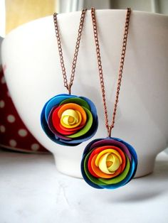 Very pretty! Rainbow pendant polymer clay. Would likely be fairly easy to duplicate...