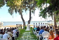 Get married at this beautiful spot on Lake Weir in Ocala, Florida!  The perfect outdoor wedding venue for Central Florida.  Looming live oaks, cool breezes and lots of shade for your guests.  Love this!