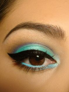 Winged aqua eye- Try Maybelline Color tattoo eye color in Tenacious Teal or Edgy Emerald, and gel liner in Black for this look! Or experiment with your own shades for something different!
